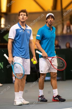 Ariel Behar (L) and Pablo Cuevas (R) of Uruguay react during their doubles match against Oliver Marach and Juergen Melzer of Austria at the Davis Cup qualifier between Austria and Uruguay in Premstaetten, near Graz, Austria, 07 March 2020.