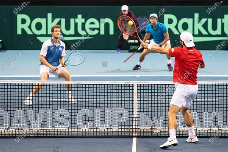 Ariel Behar (L) and Pablo Cuevas (back R) of Uruguay in action against Oliver Marach and Juergen Melzer of Austria during their doubles match of the Davis Cup qualifier between Austria and Uruguay in Premstaetten, near Graz, Austria, 07 March 2020.