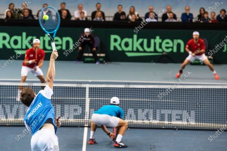 Ariel Behar (front L) and Pablo Cuevas (front R) of Uruguay in action against Oliver Marach (back R) and Juergen Melzer (back L) of Austria during their doubles match of the Davis Cup qualifier between Austria and Uruguay in Premstaetten, near Graz, Austria, 07 March 2020.