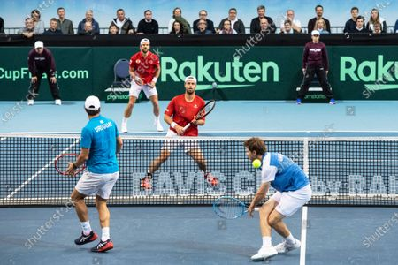Ariel Behar (front R) and Pablo Cuevas (front L) of Uruguay in action against Oliver Marach (back R) and Juergen Melzer (back L) of Austria during their doubles match of the Davis Cup qualifier between Austria and Uruguay in Premstaetten, near Graz, Austria, 07 March 2020.