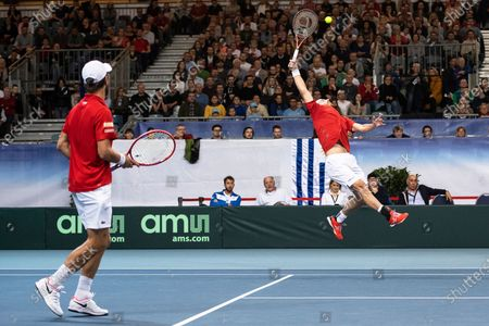 Oliver Marach (R) and Juergen Melzer (L) of Austria in action against Ariel Behar and Pablo Cuevas of Uruguay during their doubles match of the Davis Cup qualifier between Austria and Uruguay in Premstaetten, near Graz, Austria, 07 March 2020.
