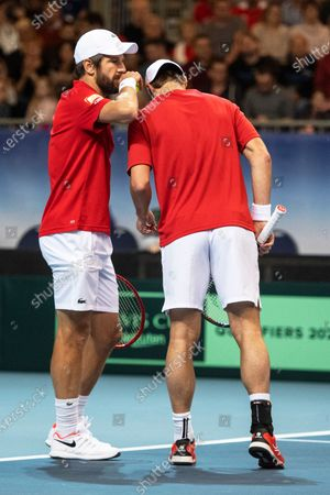 Oliver Marach (R) and Juergen Melzer (L) of Austria react during their doubles match against Ariel Behar and Pablo Cuevas of Uruguay at the Davis Cup qualifier between Austria and Uruguay in Premstaetten, near Graz, Austria, 07 March 2020.