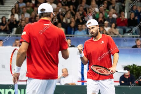 Stock Image of Oliver Marach (R) and Juergen Melzer (L) of Austria react during their doubles match against Ariel Behar and Pablo Cuevas of Uruguay at the Davis Cup qualifier between Austria and Uruguay in Premstaetten, near Graz, Austria, 07 March 2020.