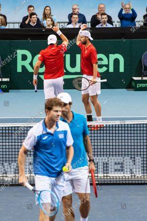 Stock Photo of Oliver Marach (back R) and Juergen Melzer (back L) of Austria react during their doubles match against Ariel Behar (front L) and Pablo Cuevas (front R) of Uruguay at the Davis Cup qualifier between Austria and Uruguay in Premstaetten, near Graz, Austria, 07 March 2020.