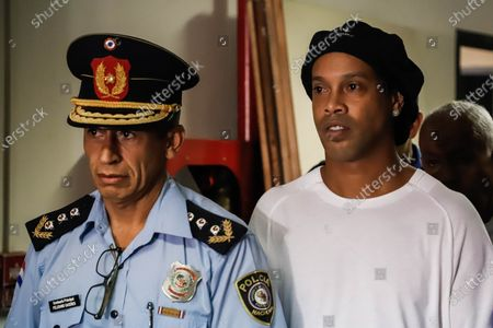 Brazilian former soccer player Ronaldo de Assis Moreira, a.k.a. Ronaldinho (R), is escorted duirng a new audience at Palace of Justice in Asuncion, Paraguay, 07 March 2020. Ronaldinho and his brother Roberto appeared on 07 March before the judge for the open cause after entering Paraguay with false passports.