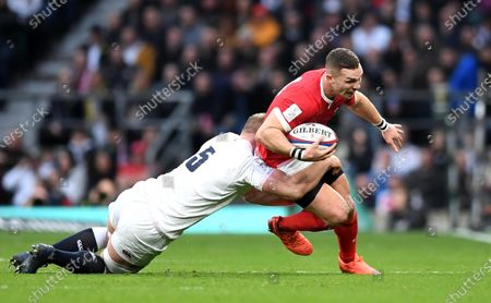 George North of Wales is tackled by George Kruis of England.