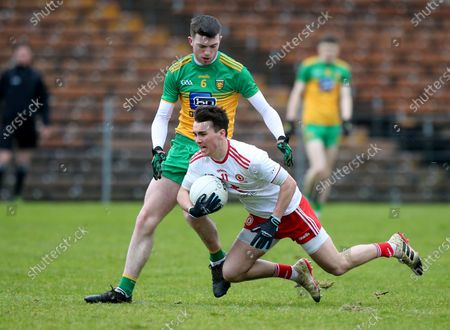 Donegal vs Tyrone. Donegal's Luke Gavigan with Tyrone's Darragh Canavan