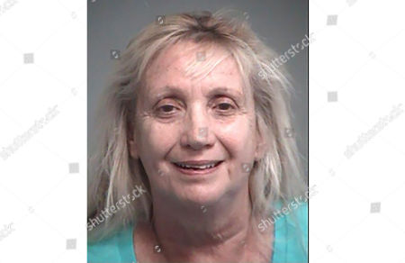 This booking photo provided by Lake County Sheriff's Office shows Cheryl A. Hall. Authorities say Hall is accused of submitting false voter registration information that switched the party affiliations of voters without their knowledge. Sheriff's investigators say Hall turned herself in to Lake County authorities . She's charged with 10 felony counts of submitting false voter information. Hall worked for an organization that helps register voters
