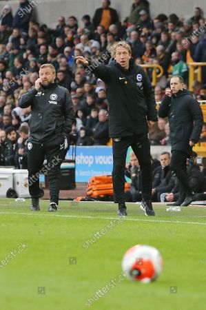Stock Image of Graham Potter Head Coach of Brighton & Hove Albion Billy Reid Assistant Head Coach of Brighton & Hove Albion directs their players during Wolverhampton Wanderers vs Brighton & Hove Albion, Premier League Football at Molineux on 7th March 2020