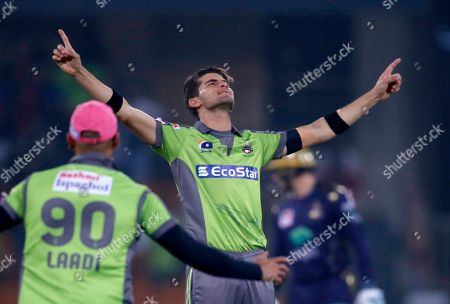 Lahore Qalandars pacer Shaheen Shah Afridi celebrates after taking the wicket of Quetta Gladiators batsman Shane Watson during a Pakistan Super League T20 cricket match in Lahore, Pakistan