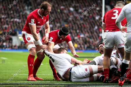 England vs Wales. Wales' Alun Wyn Jones and Leigh Halfpenny scuffle with England's George Kruis
