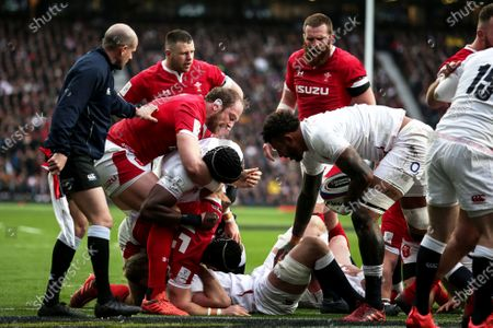 England vs Wales. Wales' Alun Wyn Jones and Leigh Halfpenny scuffle with England's George Kruis, Maro Itoje and Courtney Lawes