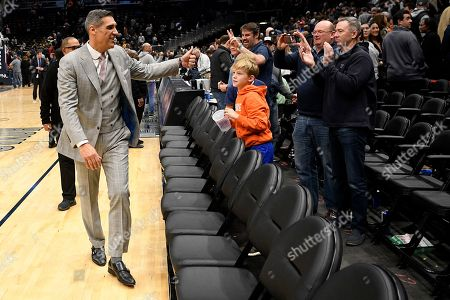 Villanova head coach Jay Wright gives a thumbs up to fans as he leaves the court after an NCAA college basketball game against Georgetown, in Washington. Villanova won 70-69