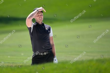 Danny Willett, of England, watches his shot from a bunker along the first fairway during the third round of the Arnold Palmer Invitational golf tournament, in Orlando, Fla