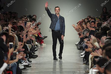 Portuguese designer Luis Buchinho waves on the catwalk at the end of his show during the Lisbon Fashion Week, in Lisbon, Portugal, 07 March 2020.
