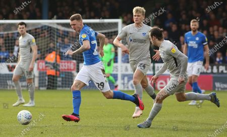 Jack Taylor of Peterborough United in action with Cameron McGeehan and Ryan Williams of Portsmouth