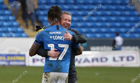 Peterborough United Manager Darren Ferguson celebrates the victory at full-time with Ivan Toney