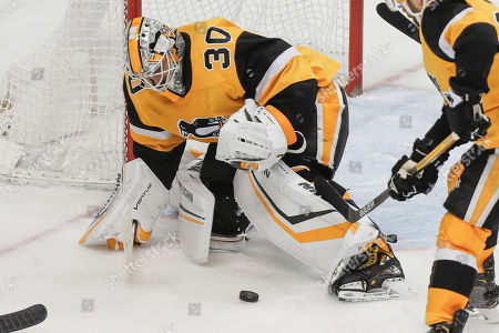 Pittsburgh Penguins goaltender Matt Murray covers the puck during the third period of an NHL hockey game against the Washington Capitals, in Pittsburgh