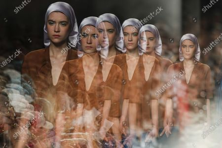 A multi-exposure image of a model displaying creations by fashion designer Ricardo Preto on the second day of the Lisbon Fashion Week in Lisbon, Portugal, 07 March 2020.