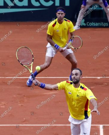 Juan Sebastian Cabal (R) and Robert Farah of Colombia (L) return a ball against Maximo Gonzalez and Horacio Zeballos of Argentina, during their qualifying round match of the 2020 Davis Cup at the Palacio de los Deportes in Bogota, Colombia, 07 March 2020.