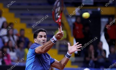 Argentine tennis player Maximo Gonzalez returns a ball against the Colombians Juan Sebastian Cabal and Robert Farah, in a match amid the qualifying round of the 2020 Davis Cup at the Palacio de los Deportes in Bogota, Colombia, 07 March 2020.