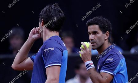 Argentine tennis players Maximo Gonzalez (R) and Horacio Zeballos (L) speak during a match against the Colombians Juan Sebastian Cabal and Robert Farah, amid the qualifying round of the 2020 Davis Cup at the Palacio de los Deportes in Bogota, Colombia, 07 March 2020.
