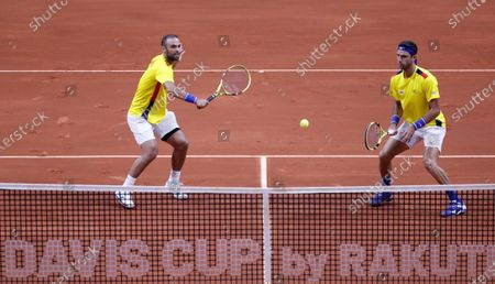 Colombian tennis players Juan Sebastian Cabal (L) and Robert Farah (R) return a ball against the Argentines Maximo Gonzalez and Horacio Zeballos, in a match amid the qualifying round of the 2020 Davis Cup at the Palacio de los Deportes in Bogota, Colombia, 07 March 2020.