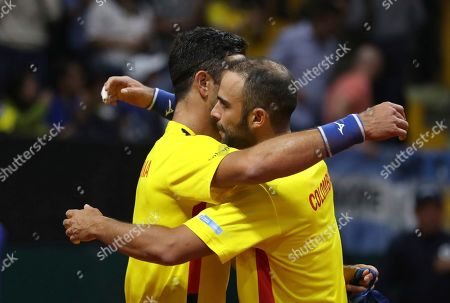 Robert Farah, Juan Sebastian Cabal. Colombia's Robert Farah, left, and Juan Sebastian Cabal, embrace in celebration after defeating Argentina's Horacio Zeballos and Maximo Gonzalez, at the end of their Davis Cup Rakuten Qualifiers tennis doubles match, in Bogota, Colombia