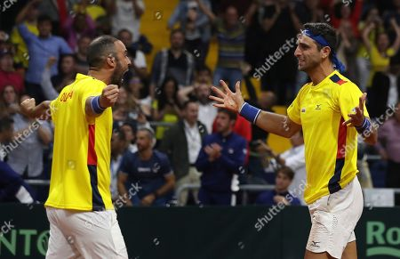Robert Farah, Juan Sebastian Cabal. Colombia's Juan Sebastian Cabal, left and Robert Farah, celebrate after defeating Argentina's Horacio Zeballos and Maximo Gonzalez, at the end of their Davis Cup Rakuten Qualifiers tennis doubles match, in Bogota, Colombia