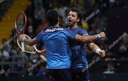 Horacio Zeballos, M'ximo Gonzalez. Argentina's Maximo Gonzalez, left, and partner Horacio Zeballos, celebrate a point against Colombia's Robert Farah and Juan Sebastian Cabal, during their Davis Cup Rakuten Qualifiers tennis doubles match, in Bogota, Colombia, Saturday, March, 7, 2020
