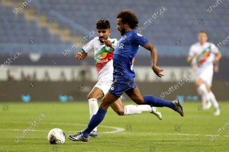 AL- Hilal's Yasser Al-Shahrani (R) in action against Al-Ettifaq's Mohammed Alkuwaykibi (L) during the Saudi Professional League soccer match between AL- Hilal and Al-Ettifaq at King Saud University Stadium, Riyadh, Saudi Arabia, 07 March 2020.