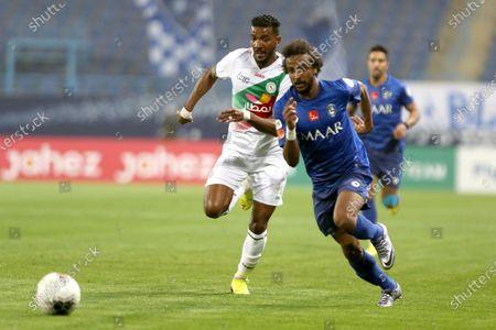 AL- Hilal's Yasser Al-Shahrani (R) in action against Al-Ettifaq's Saleh Alqumayzi (L) during the Saudi Professional League soccer match between AL- Hilal and Al-Ettifaq at King Saud University Stadium, Riyadh, Saudi Arabia, 07 March 2020.