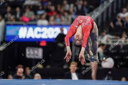 Jin Zhang of China performs on the floor during the America Cup gymnastics competition, in Milwaukee