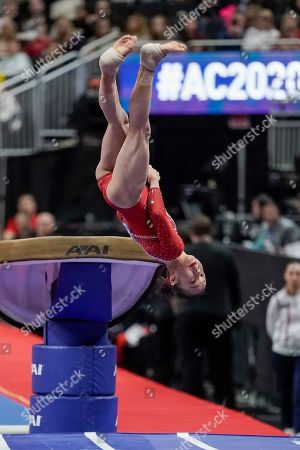 Jin Zhang of China performs on the vault during the America Cup gymnastics competition, in Milwaukee