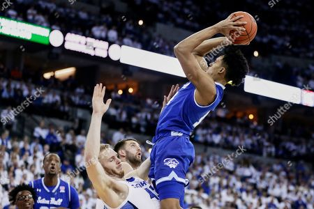 Seton Hall's Jared Rhoden, right, is fouled by Creighton's Kelvin Jones (43) during the first half of an NCAA college basketball game in Omaha, Neb