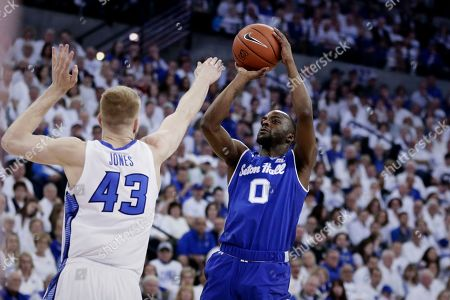 Seton Hall's Quincy McKnight (0) shoots for three points against Creighton's Kelvin Jones (43) during the first half of an NCAA college basketball game in Omaha, Neb