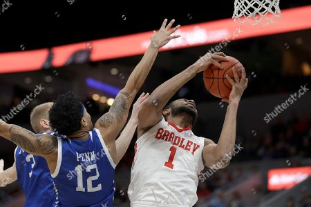 Bradley's Ari Boya (1) heads to the basket as Drake's Roman Penn (12) defends during the first half of an NCAA college basketball game in the semifinal round of the Missouri Valley Conference men's tournament, in St. Louis