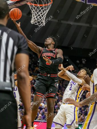 Stock Photo of Georgia's Anthony Edwards (5) drives to the basket past LSU's Trendon Watford (2) during NCAA Basketball action between the Georgia Bulldogs and the LSU Tigers at the Pete Maravich Assembly Center in Baton Rouge, LA. LSU defeated Georgia 94-64