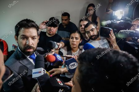 Prosecutor Osmar Legal (L) speaks with the press about the case of the Brazilian international Ronaldinho and his brother in Asuncion, Paraguay, 07 March 2020. Ronaldinho and his brother Roberto were transferred on 07 March to an Asuncion prison after the preventive prison order signed by the judge in the Palace of Justice. Ruiz ordered to the Specialized Association, a headquarters of the National Police, in Asunción, which houses criminals with causes of drug trafficking and where the two brothers had spent their first night on Friday after their arrest.