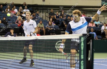 Denis Istomin (UZB) returns volley at the net while Sanjar Fayziev (UZB) watches during a Davis Cup by Rakuten Qualifier doubles match between Sanjar Fayziev (UZB)/Denis Istomin (UZB) and Bob Bryan (USA)/Mike Bryan (USA) at the Neal Blaisdell Center in Honolulu, HI - Michael Sullivan/CSM
