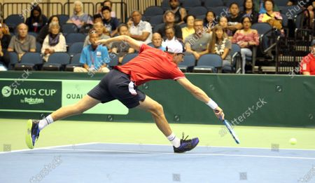 Mike Bryan (USA) stretches for a ball during a Davis Cup by Rakuten Qualifier doubles match between Sanjar Fayziev (UZB)/Denis Istomin (UZB) and Bob Bryan (USA)/Mike Bryan (USA) at the Neal Blaisdell Center in Honolulu, HI - Michael Sullivan/CSM