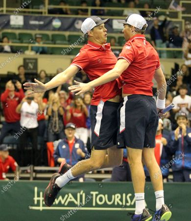 The Bryans celebrate victory with their signature chest bump during a Davis Cup by Rakuten Qualifier doubles match between Sanjar Fayziev (UZB)/Denis Istomin (UZB) and Bob Bryan (USA)/Mike Bryan (USA) at the Neal Blaisdell Center in Honolulu, HI - Michael Sullivan/CSM