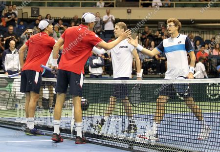Players meet at the net after Davis Cup by Rakuten Qualifier doubles match between Sanjar Fayziev (UZB)/Denis Istomin (UZB) and Bob Bryan (USA)/Mike Bryan (USA) at the Neal Blaisdell Center in Honolulu, HI - Michael Sullivan/CSM