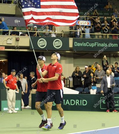 The Bryans take a lap with the flag after Davis Cup by Rakuten Qualifier doubles match between Sanjar Fayziev (UZB)/Denis Istomin (UZB) and Bob Bryan (USA)/Mike Bryan (USA) at the Neal Blaisdell Center in Honolulu, HI - Michael Sullivan/CSM