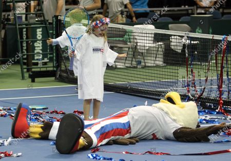 Mascot Ace has fun with the Bryan children following the Davis Cup by Rakuten Qualifier doubles match between Sanjar Fayziev (UZB)/Denis Istomin (UZB) and Bob Bryan (USA)/Mike Bryan (USA) at the Neal Blaisdell Center in Honolulu, HI - Michael Sullivan/CSM