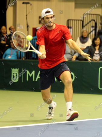 Stock Photo of Tommy Paul (USA) returns volley during Davis Cup by Rakuten Qualifier dead rubber match between Denis Istomin (UZB) and Tommy Paul (USA) at the Neal Blaisdell Center in Honolulu, HI - Michael Sullivan/CSM