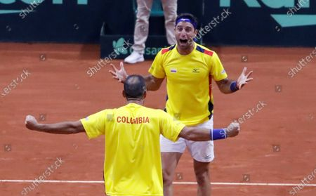 Colombian tennis players Juan Sebastian Cabal (L) and Robert Farah (R) celebrate after beating the Argentine team Maximo Gonzalez and Horacio Zeballos, after a match in the qualifying phase of the Davis Cup 2020 between Colombia and Argentina, at the Palacio de los Deportes (Sports Palace) in Bogota, Colombia, 07 March 2020.