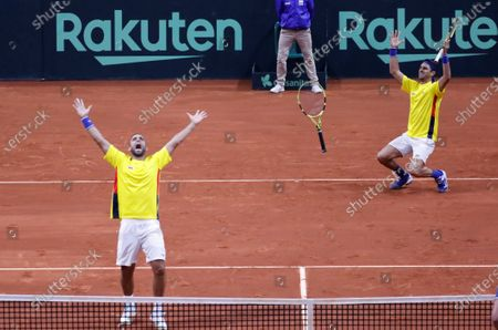 Colombian tennis players Juan Sebastian Cabal (L) and Robert Farah (R) celebrate after beating the Argentine team Maximo Gonzalez and Horacio Zeballos, after a match in the qualifying phase of the Davis Cup 2020 between Colombia and Argentina, at the Palacio de los Deportes (Sports Palace) in Bogota, Colombia. 07 March 2020.