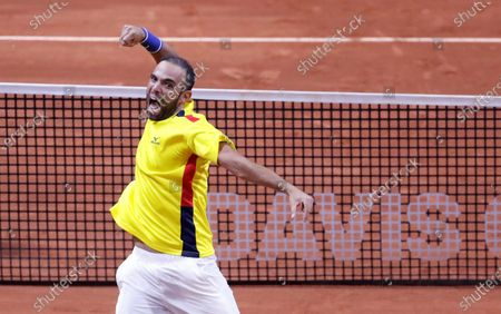 Stock Photo of The Colombian tennis player Juan Sebastian Cabal celebrates after winning with his teammate and compatriot Robert Farah (out of frame) to the Argentine team Maximo Gonzalez and Horacio Zeballos, after a match in the qualifying phase of the Davis Cup 2020 between Colombia and Argentina, at the Palacio de los Deportes (Sports Palace) in Bogota, Colombia, 07 March 2020.