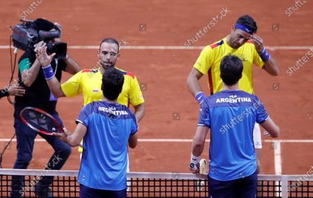 Colombian tennis players Juan Sebastian Cabal (L) and Robert Farah (R) celebrate after beating the Argentine team (down) Maximo Gonzalez and Horacio Zeballos, after a match in the qualifying phase of the Davis Cup 2020 between Colombia and Argentina, at the Palacio de los Deportes (Sports Palace) in Bogota, Colombia, 07 March 2020.